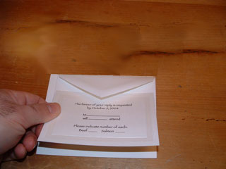 Invitation with tissue laid on top
